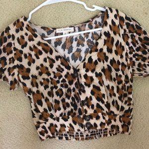 Cheetah print button down blouse.